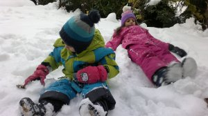 Nick and Lou lying in the snow