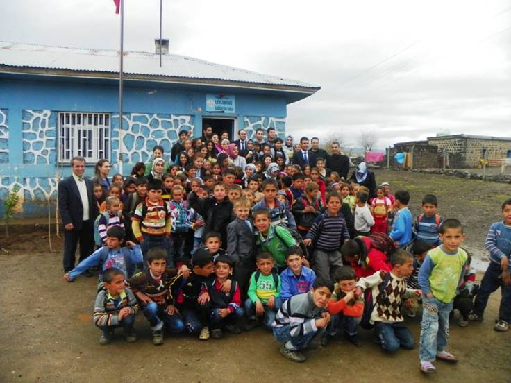 Osman and his students (English language teacher candidates) while reaching out to the students in a rural village as part of a community service project they developed together.