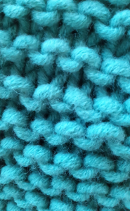 A close-up of the scarf I knit for Maggie