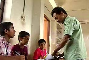 Abdul Malik and his students (Image taken from http:///www.ndtv.com)